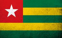 The Togolese Republic (Togo) National flag. Grunge background