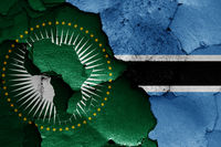 flags of African Union and Botswana painted on cracked wall