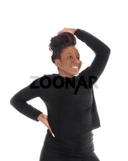 An African woman standing in a black dress waist up