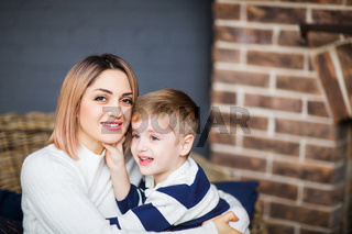Young mother and son in cozy room