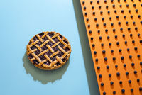 Whole blueberry pie with a lattice crust and blueberries fruits pattern