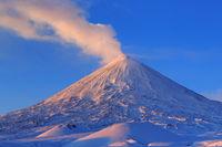 Active volcano of Kamchatka Peninsula: eruption Klyuchevskoy Volcano at sunrise