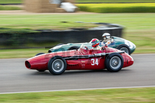 GOODWOOD, WEST SUSSEX/UK - SEPTEMBER 14 : Vintage Racing at Goodwood on September 14, 2012. Two unidentified people