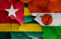 flags of Togo and Niger painted on cracked wall