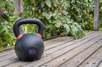 iron kettlebell on wooden deck