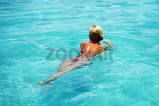 Beautiful woman swimming