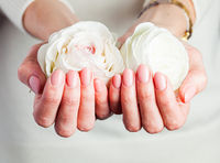 Woman hands care and therapy concept. Tender pink manicured nails, closeup.