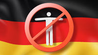 Warning sign with crossed out man on a background German flag.