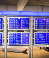 Flights information board airport terminal