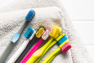 Various colorful toothbrushes.