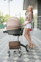 Beautiful happy woman with a pram