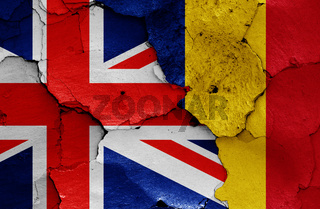 flags of UK and Romania painted on cracked wall