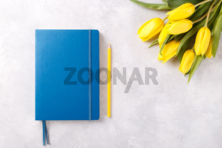 Blue notepad and tulips
