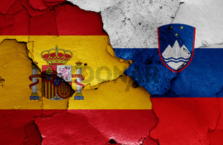 flags of Spain and Slovenia painted on cracked wall
