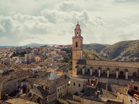 Aerial image ancient architecture view of Bocairent against hills and cloudy sky background. Valencian Community, Spain