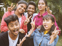 Young teenage friends taking selfie with funny faces - Concept of youth happy friendship having fun together - Millennials of selfie generation.