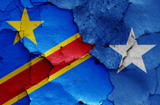 flags of DR Congo and Somalia painted on cracked wall