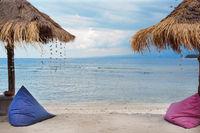 Umbrellas and bean bag at the seashore.