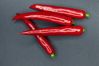Red hot chili peppers on a dark background