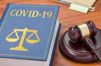 Law book with a gavel - COVID-19