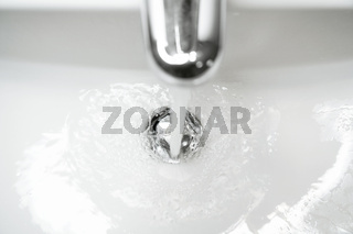 bathroom sink or hand basin with running water