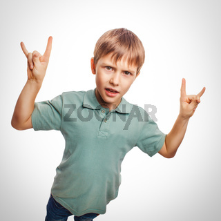 boy teenager shows gesture hands metal rock devil emotion