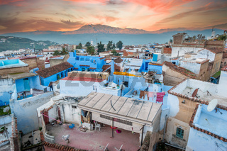 Amazing sunrise over rooftops of Chefchaouen's Blue City, Medina, Morocco