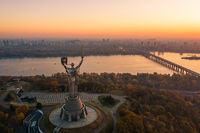 Kiev skyline over beautiful fiery sunset, Ukraine. Monument motherland.