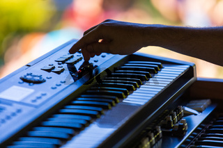 Hands of an electronic keyboard player
