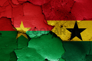 flags of Burkina Faso and Ghana painted on cracked wall