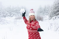 Woman throwing a large snowball