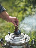 Traditional russian samovar with smoke
