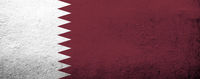 The State of Qatar National flag. Grunge background