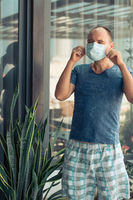 Man wearing facial disposable mask. Virus protection
