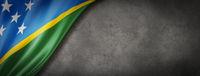 Solomon Islands flag on concrete wall banner