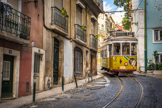 LISBON, PORTUGAL - July 1, 2018: Vintage tram in the narrow street of Alfama district in Lisbon.