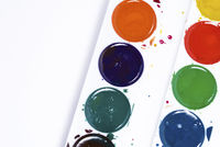Top view of paintbrushes palette on white paper background