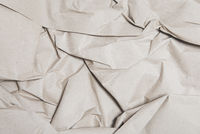 Texture of crumpled kraft paper brown color, close up. Natural background for design work