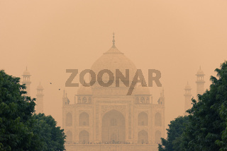 The backside of the Taj Mahal in Agra, India on overcast day with smog