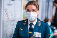 UKRAINE, KIEV - MAY 26, 2020: subway station Zoloty Vorota (Golden Gate). Metro worker in uniform is on duty at the station