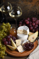 Antipasti. Cheese camembert with fruit and wine