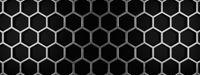 Metal honeycomb grid on a black background