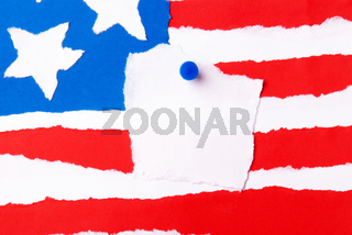 An American Flag out of Paper with a Notice Paper in the Middle with Copy Space