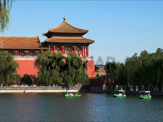 holidaymakers riding paddle boats outside the forbidden city, beijing