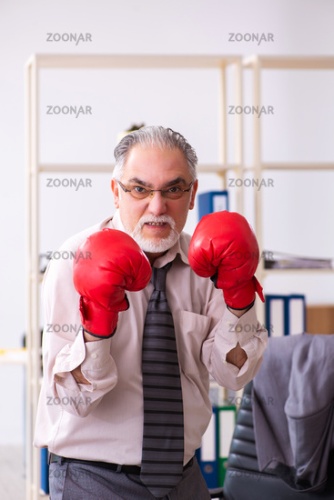 Businessman angry and furious at the workplace
