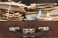 Bunches of paper mails of 20 century in the vintage suitcase