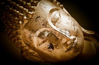 Close up face of Golden Buddha. Thailand