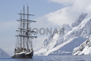tourist ship sailing summer day on a background of mountain peaks