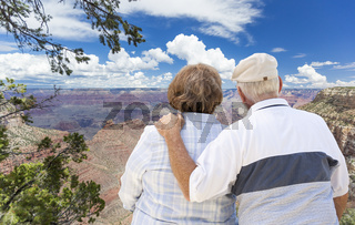 Happy Senior Couple Looking Out Over The Grand Canyon