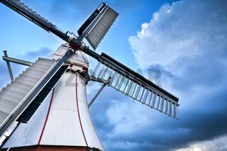 white Dutch windmill over blue sky